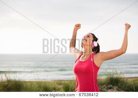 Female Successful Athlete Celebrating Fitness Goals