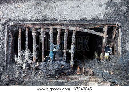 Damaged Drain Grate With The Garbage