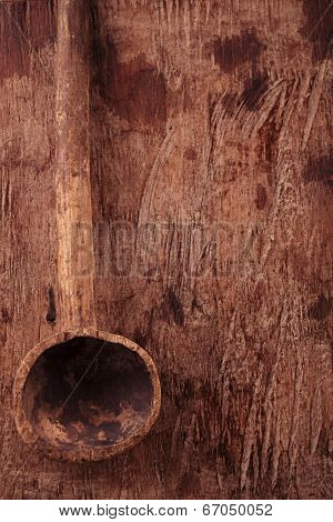 antique wooden spoon on old wooden table in rustic style