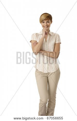 Portrait of casual young woman holding pen, thinking. Isolated on white.