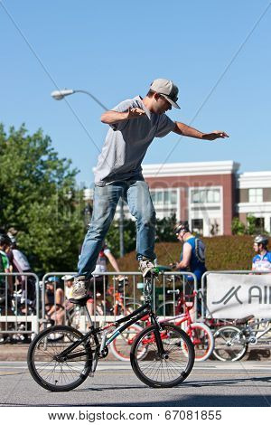 Man Practices Flatland Bike Tricks Before Bmx Competition