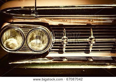 Close-up of retro car facia with chrome grille