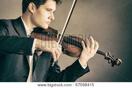 Man Violinist Playing Violin. Classical Music Art