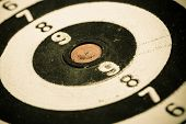 Closeup of old dirty black and white target as sport background. Skeet trap shooting. poster