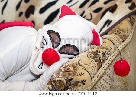 Portrait of a game character. Cosplay character resting on the sofa. Shot indoors poster