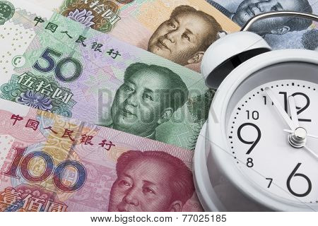 Chinese Money (rmb) And Clock. Time Is Money. Business Concept.