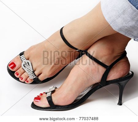 Female feet with fancy shoes