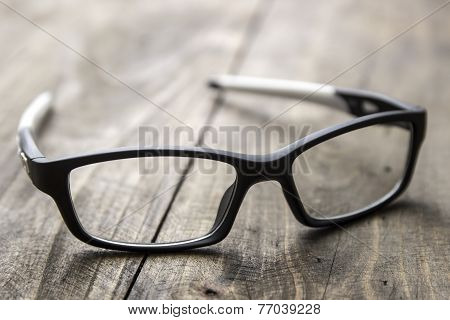 Optical Glasses On Wooden Background