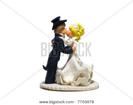Wedding cake dolls on a white background