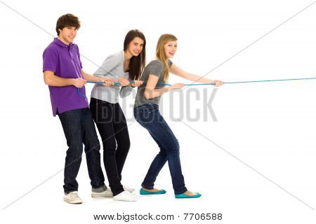Friends pulling a rope