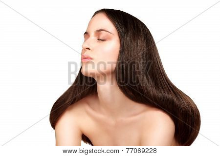 Beauty Model Showing Perfect Skin And Long Healthy Brown Hair