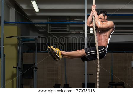 Fitness Athlete Climbing A Rope
