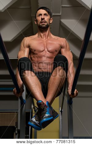Fit Athlete Working Out Exercise On Parallel Bars poster