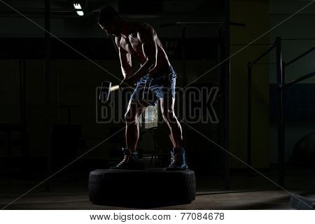 Athletic Man Hits Tire