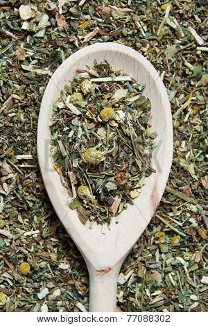 Wooden spoon and various herbs in a herbalist - studio shoot poster