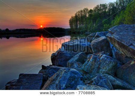 Sun Setting On A Lake
