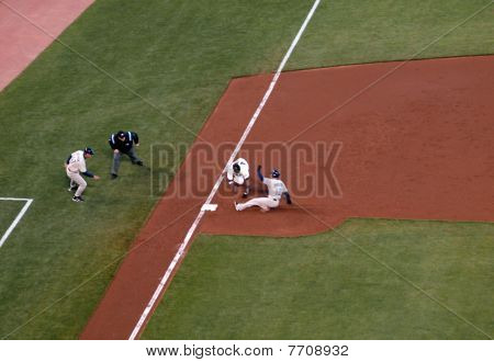 Giants Third Baseman Reaches To Tag Padre Baserunners Slides Feet First To Third Base
