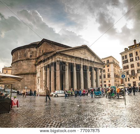 ROME - NOVEMBER 17: Tourists visit the Pantheon on November 17, 2014 in Rome, Italy. Pantheon is a famous monument of ancient Roman culture, the temple of all the gods, built in the 2nd century.