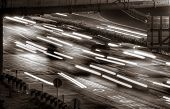 Beautiful urban traffic scenes of cars and lights motion blurred. poster