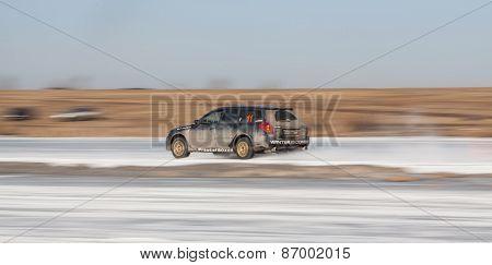 Blue subaru Legacy on ice track