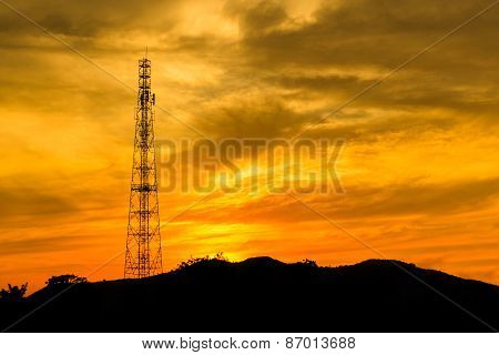 Telecommunications Tower With Sunset Sky.