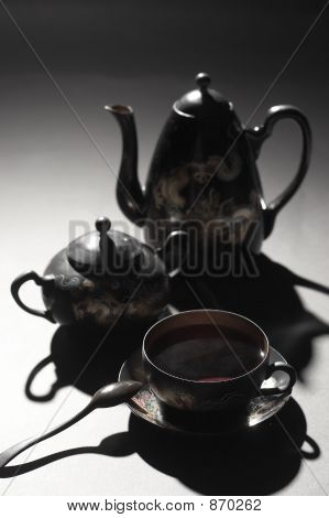 evening still life with wood tea set poster