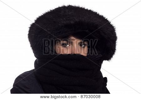 Girl with winter coat and mouth covered