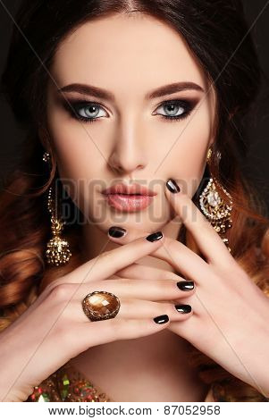 Beautiful Young Woman With  Dark Hair And Bright Makeup,with Bijou