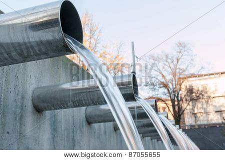 Water Flowing Out From Steel Pipes