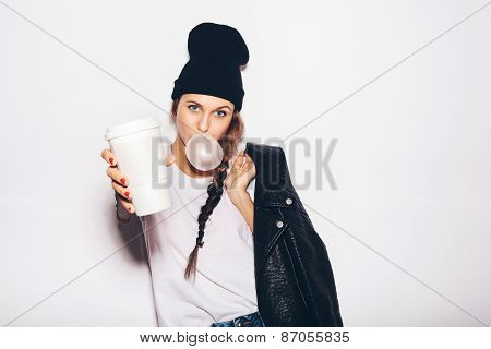 Swag Girl In Black Beanie With Cup Of Coffee And Looking At Camera