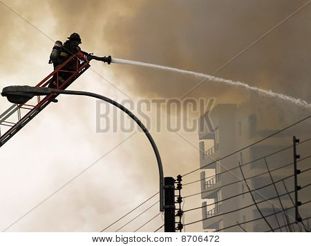 Fireman putting out a fire