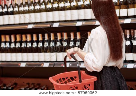 Woman in a liquor store