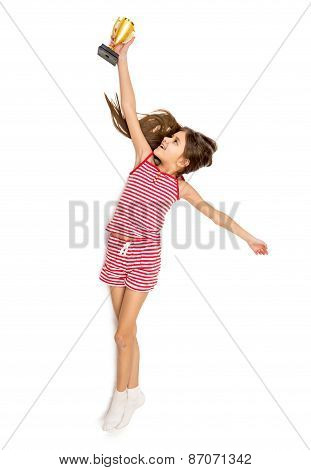 Isolated Shot Of Happy Active Girl Reaching High For Trophy Cup