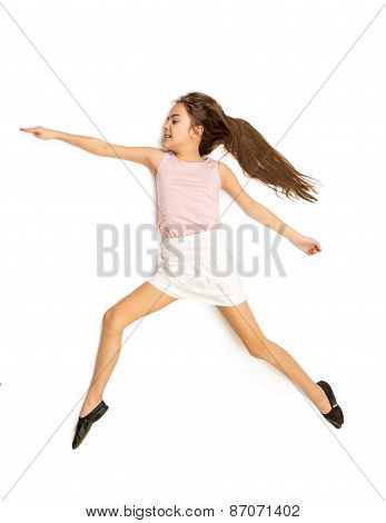 Isolated Shot Of Cute Girl Jumping In Dance
