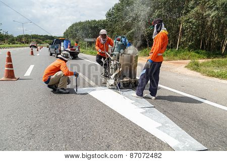 Suratthani, Thailand - January 9 : Team Of Civil Worker Work On Highway, They Draw White Line On Roa