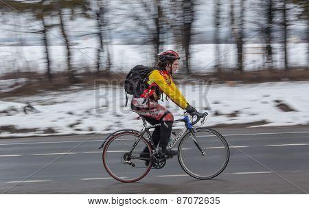 Man riding his bike. Panning