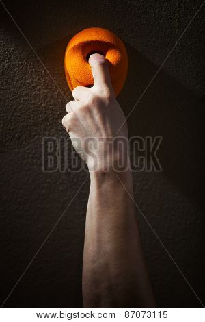 Close up of man gripping handhold with one finger