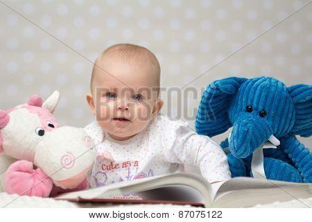 Baby Girl Reading A Book
