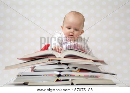 Baby With Pile Of Books