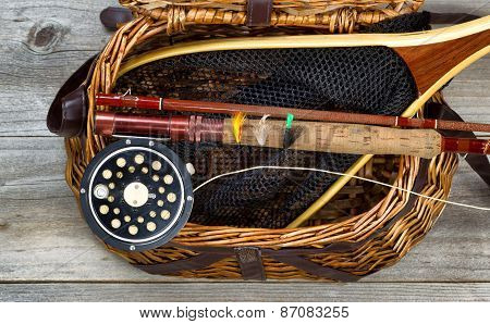Creel Filled With Trout Fishing Equipment