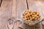 Canned Chick Peas (close-up shot) on vintage wooden background poster
