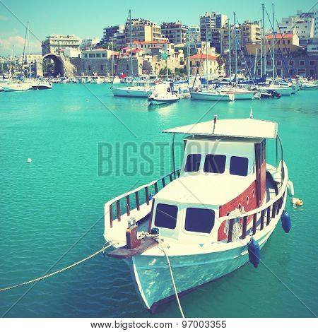 Fishing boat in port of Heraklion, Crete, Greece. Instagram style filtered image