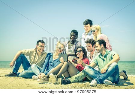Group Of Young Hipster Best Friends With Digital Tablet Sitting At The Beach - Multicultural Concept