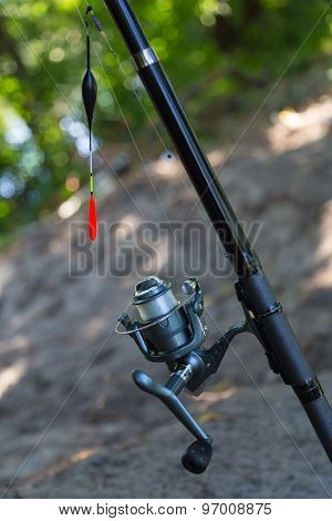 Fishing Rod With Inertialess Reel And  Float.