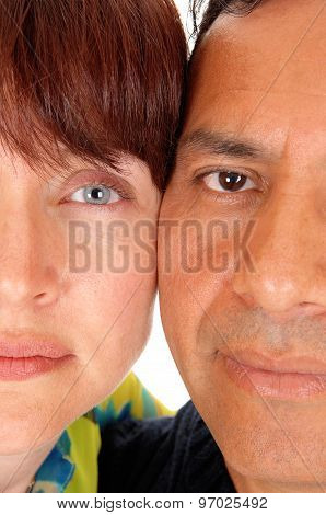 The Halve Faces Of A Middle Age Couple.