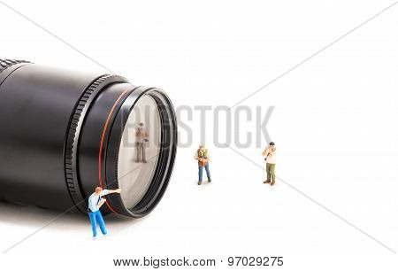 Image Of Mini Figure Dolls Photographer Take Picture On Big Dslr Lens.