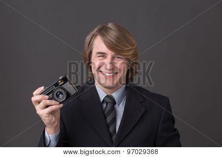 Businessman with photocamera