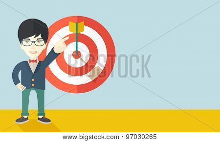 A japanese salesman happy standing while his hand pointing to the arrow from target pad shows that he hit his target sales. Business concept. A Contemporary style with pastel palette, soft blue tinted