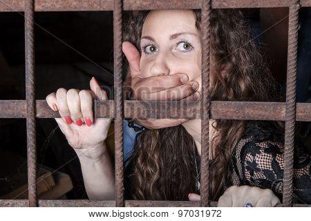 Woman Hostage Behind Bars