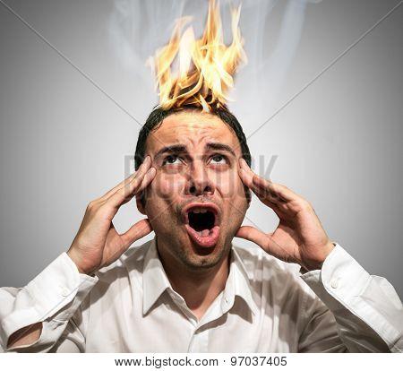 Man having his braing burning up due to stress